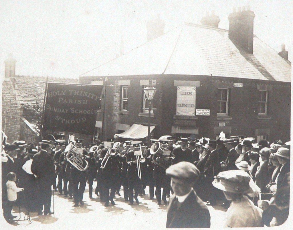 Undated photograph from Howard Beard's collection shows the Holy Trinity Parish Sunday School parade outside the church