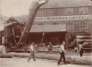 Sawmill staff pose for the camera along with one of the two steam cranes on site. This an early photo that pre-dates the devastating fire of August 1911. The mill was rebuilt with improvements made, including the installation of a large Paxman-Lentz stationary steam engine, this drove line shafts to various saws in the main building.